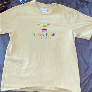 ISO WE'RE NEW HERE YELLOW TEDDY FRESH SHIRT